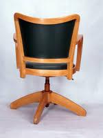 fauteuil de bureau en bois pivotant chaise a accoudoirs fauteuil bureau tournant 1950 vintage
