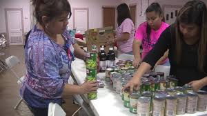 volunteers providing families with food during time of grief