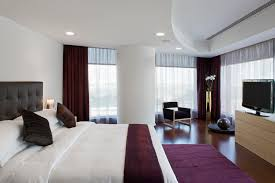 bedroom curtain ideas brown smooth curtain big round wall lamp