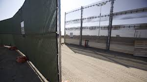 fence rises around site for border wall models law enforcement