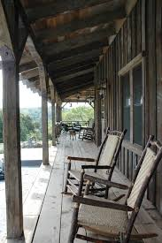 front porch rocking chairs porch rustic with cabin deck gravel