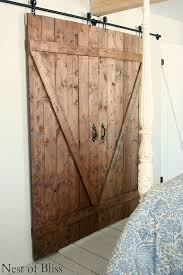 How To Build Barn Doors Sliding Great Tutorial On Diy Barn Door Hardware Very Clever Diy