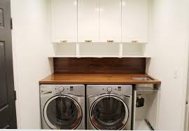 how to install base cabinets in laundry room a walnut counter and backsplash in the laundry room chris