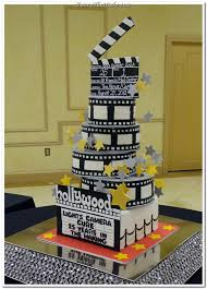 hollywood movies novelty cake featuring three stacked film reels
