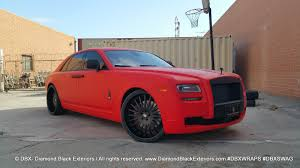 rolls royce gold and red home diamond black exteriors dbx wraps
