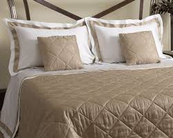tuscany luxurious bed linens in the linen cupboard
