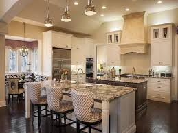 kitchen island with sink and seating with handelier and breakfast