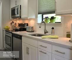white shaker kitchen cabinets backsplash shaker cabinets in a galley kitchen homecrest
