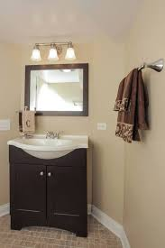 Bathroom Vanity With Farmhouse Sink by Contemporary Powder Room With Powder Room By Katlia Construction