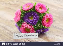 happy birthday card with colorful aster flowers bouquet stock