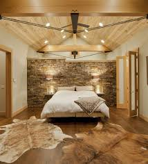 25 bedrooms that celebrate the textural brilliance of stone walls contemporary bedroom with montana limestone headboard wall and a wooden ceiling design kelly