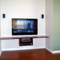 furniture brown wooden shelves under black led tv having drawers