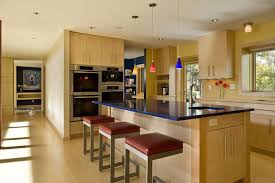 modern kitchen with stainless steel appliances and monochromatic