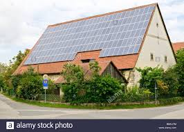 solar panels on roof of old farm building in franconia bavaria