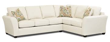 l shaped white sectional sofa having backrest and arm on short