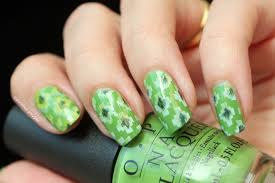 notd ikat nail design with three shades of green polished polyglot