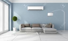 blue living room with gray sofa and air conditioner on wall