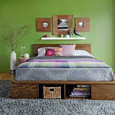 calming colors for bedrooms green wall color and wooden platform