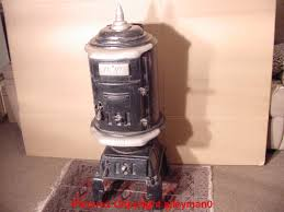 old mw wood burning cylinder stove complete and working antique