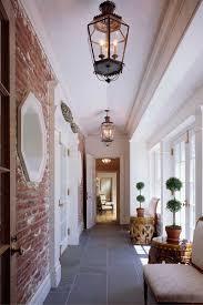 gorgeous exposed brick wall flagstone floor lantern light