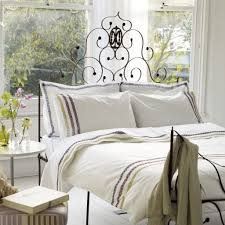 bedroom gothic black wooden bed frame in white bed sheets also