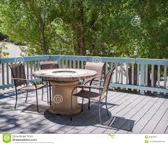 Garden Table And Chairs With Fire Pit Patio Table With Fire Pit And Chairs On Deck Stock Photo Image
