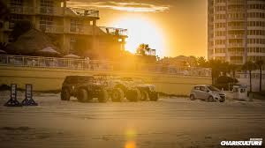 yellow jeep on beach the charis culture run the race