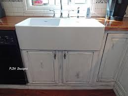 decorating rectangle white porcelain apron sink on white kitchen