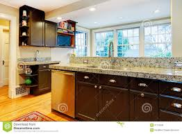 kitchen design black wood cabinets marble counter top stock
