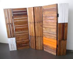 assorted color pine wood pallet folding room divider placed on