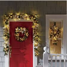 gold poinsettia teardrop swag wreath and garland from country