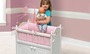 badger basket doll crib with cabinet badger basket deluxe doll crib and accessories groupon