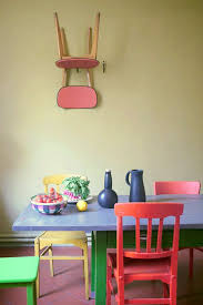 colorful dining table multi colored dining chairs a playful touch for the décor