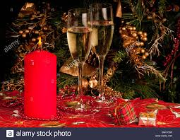 two glasses of champagne christmas candle presents and