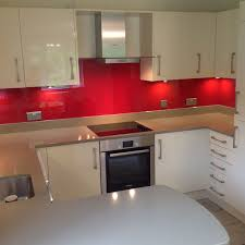 cucina kitchens contemporary and modern kitchens avant ivory with striking red backsplash