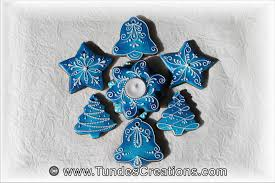 the gingerbread artist blue christmas ornaments and candle holder
