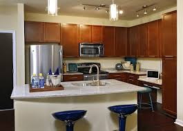 L Shaped Kitchen Layout With Island by Brown Wooden L Shaped Kitchen Cabinet With Storage Also White