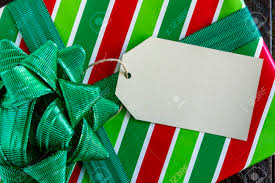 present wrapped in and green striped wrapping paper