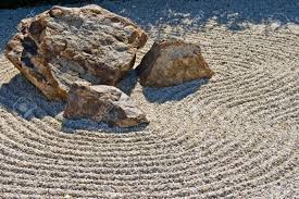 japanese rock garden showing raked gravel stones stock photo