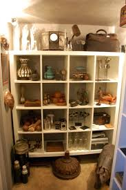 Expedit Room Divider Curio Cabinet In Spaces Los Angeles With Vintage Travel Trailer
