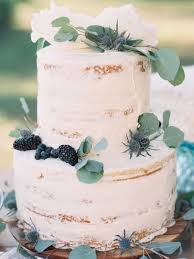 wedding cake greenery picture of two tiered cake topped with greenery blackberries and