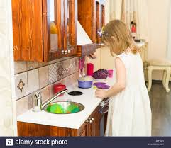 kid kitchen pot stock photos kid kitchen pot stock images alamy active little preschool age child cute toddler girl with blonde curly hair shows playing