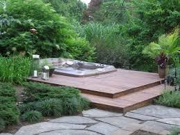 bathroom back yard two level wooden deck with corner tub