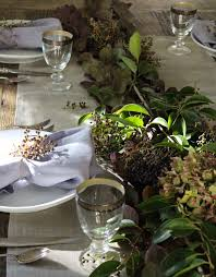 diy foraged thanksgiving tabletop with berries and branches