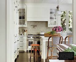 white kitchen with pretty taupe subway tile backsplash kitchen