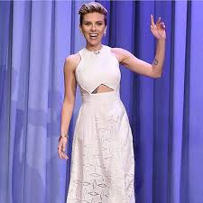 scarlett johansson shows new tattoo compares with wiz khalifa