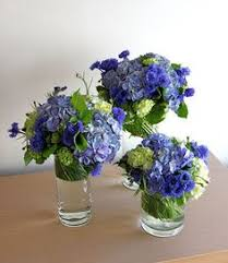 Blue Wedding Centerpieces by Light And Dark Blue With White Flowers Table Spring And Summer