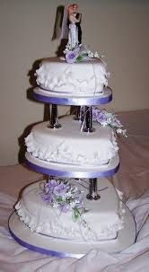 How To Decorate Heart Shaped Cake 3 Tier Heart Shaped Cake On Pillars With Gumpaste Flowers