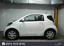 toyota iq toyota iq two seater car parked in underground car park stock