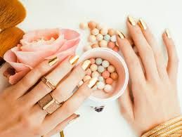 golden hand rings images Woman hands with golden manicure and many rings holding brushes jpg